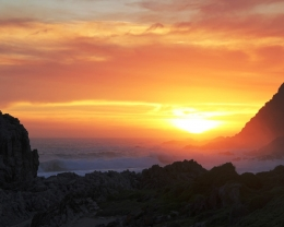 Sun setting over the rugged coast line of Tsitsikamma National Park